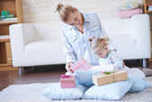 Woman and daughter opening giftboxes — Stock Photo