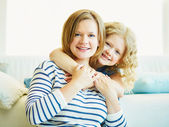 Woman and her child at home — Stock Photo