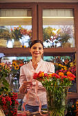 Woman at flower shop — Stock Photo