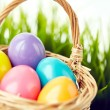 Colorful Easter eggs in basket — Stock Photo #66456593