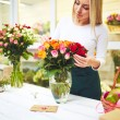 Florist taking care of flowers — Stock Photo #66458891