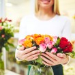 Florist holding fresh roses — Stock Photo #66458927