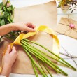 Florist tying up fresh flowers — Stockfoto #66459061