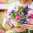 Florist holding bouquet of  flowers — Stock Photo #66459227