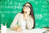 Girl in eyeglasses making notes — Stock Photo