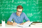 Making notes at lesson — Stock Photo