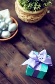Giftbox and Easter eggs — Stock Photo