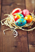 Easter painted eggs in nest — Stock Photo