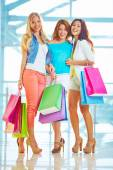 Happy shopaholics with paperbags — Stock Photo