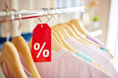 Clothes on hangers for sale — Stock Photo