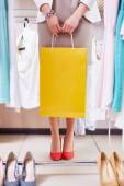 Young woman in boutique — Stock Photo