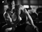 Man exercising with barbell — Stock Photo