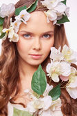 Spring woman in floral wreath — Stock Photo