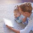 Young woman using touchpad with daughter — Stock Photo #66460751