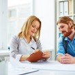 Woman assigning tasks for man — Stock Photo #69404669