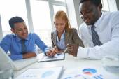 Business people watching financial data — Stock Photo