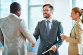 Happy businessmen handshaking — Stock Photo