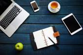 Gadgets and supplies on table — Stock Photo