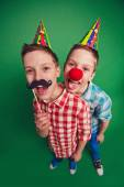Twins with clown noses — Stock Photo
