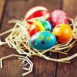 Easter eggs in hay nest — Stock Photo #69411369