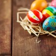 Easter eggs in hay nest — Stock Photo #69411371