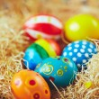 Easter eggs in hay nest — Stock Photo #69411387