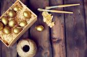 Gold leaf for Easter eggs — Stock Photo