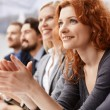 Businesswoman applauding at conference — Stock Photo #72148195