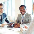 Businessmen listening to young businesswoman — Stock Photo #72149443