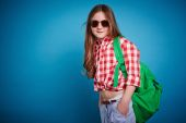 Schoolgirl in casual wear and sunglasses — Stock Photo