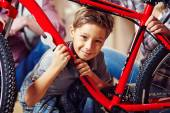 Boy with wrench and bicycle — Stock Photo