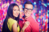Amorous young couple enjoying party — Stock Photo
