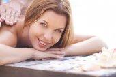 Woman enjoying massage — Stock Photo
