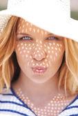 Flirty woman giving air kiss — Stock Photo