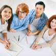 College students sitting by desk — Stock Photo #73936201