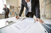 Businessman over desk working with papers — Stock Photo