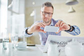 Businessman take photo of  newspaper — Stock Photo