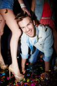 Man having fun with girls in club — Stock Photo