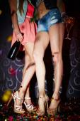 Legs of girls in high heeled shoes — Stock Photo