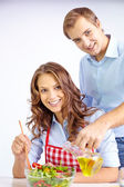 Couple cooking vegetable salad — Stock Photo