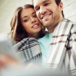 Restful couple browsing in net — Stock Photo #74094857