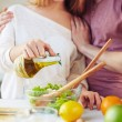 Woman seasoning salad with olive oil — Stock Photo #74095161