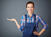 Woman in coveralls keeping her palm open — Stock Photo