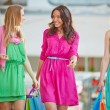 Women with paper bags  in the mall — Stock Photo #76977927