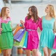 Women with paper bags  in the mall — Stock Photo #76977925