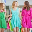 Women with paper bags  in the mall — Stock Photo #76977929