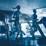 People running on treadmills — Stock Photo #76979271