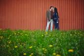 Couple kissing on green lawn — Stock Photo
