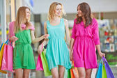 Women with paper bags  in the mall — Stock Photo
