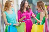 Women with paper bags in mall — Stock Photo